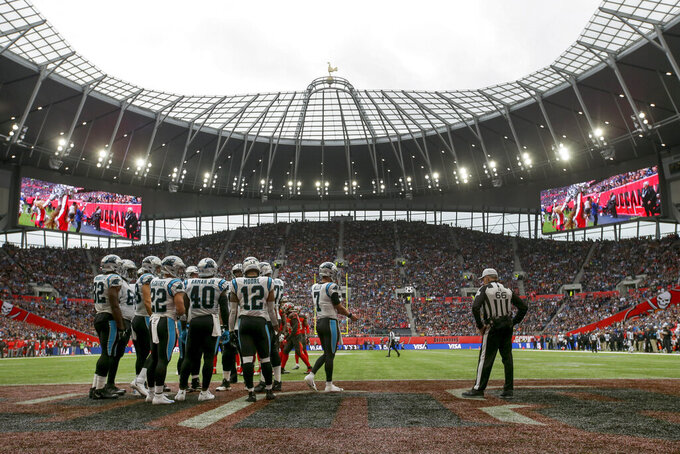 The Carolina Panthers huddle in the end zone during the second quarter of an NFL football game against the Tampa Bay Buccaneers, Sunday, Oct. 13, 2019, at Tottenham Hotspur Stadium in London. (AP Photo/Tim Ireland)