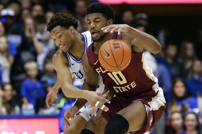 Duke forward Wendell Moore Jr. and Florida State forward Malik Osborne (10) struggle for possession of the ball during the second half of an NCAA college basketball game in Durham, N.C., Monday, Feb. 10, 2020. (AP Photo/Gerry Broome)