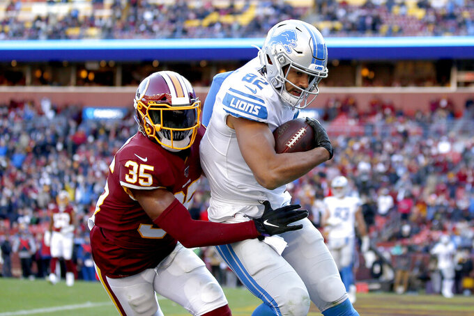 Detroit Lions tight end Logan Thomas (82) scores a touchdown on a pass from quarterback Jeff Driskel, not visible, as Washington Redskins free safety Montae Nicholson (35) tries to bring him down in the end zone during the second half of an NFL football game, Sunday, Nov. 24, 2019, in Landover, Md. (AP Photo/Alex Brandon)