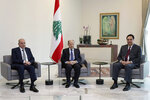In this photo released by the Lebanese Government, Lebanese President Michel Aoun, center, meets with Prime Minister Hassan Diab, right, and Parliament Speaker Nabih Berri, at the Presidential Palace in Baabda, east of Beirut, Lebanon, Thursday, Feb. 13, 2020. Lebanon's Finance Minister Ghazi Wazni said Thursday the new government is facing the difficult task of deciding whether to pay or default on its $1.2 billion Eurobond maturing next month. (Dalati Nohra/Lebanese Government via AP)