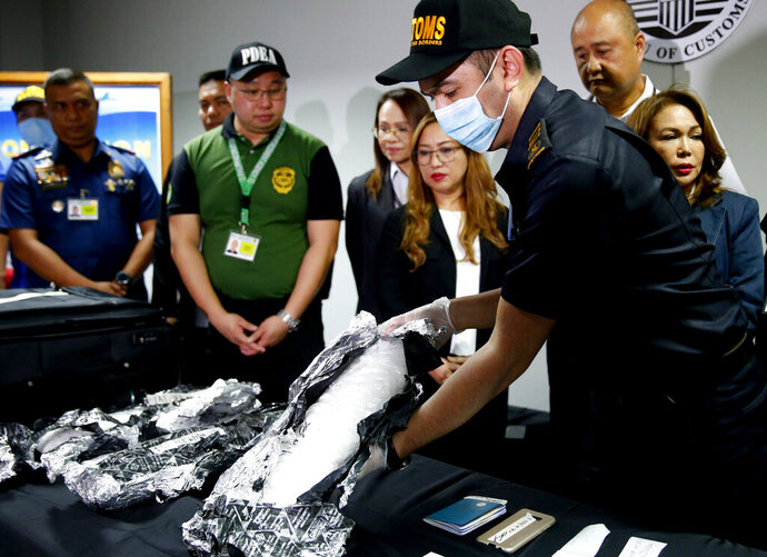 Bureau of Customs and airport authorities display 8 kilograms of the illegal drug methamphetamine hydrochloride locally known as