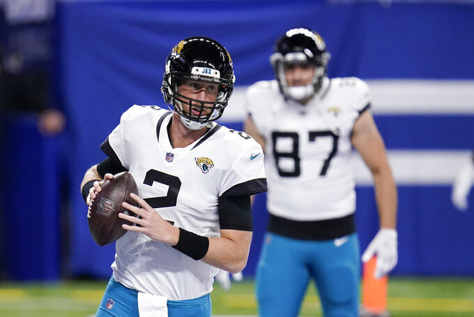 Jacksonville Jaguars quarterback Mike Glennon (2) warms up before an NFL football game against the Indianapolis Colts, Sunday, Jan. 3, 2021, in Indianapolis. (AP Photo/Michael Conroy)