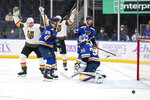 Vegas Golden Knights' Tomas Nosek, left, celebrates after scoring past St. Louis Blues goaltender Ville Husso (35) and Vince Dunn (29) during the first period of an NHL hockey game Monday, April 5, 2021, in St. Louis. (AP Photo/Jeff Roberson)