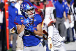 Kansas wide receiver Luke Grimm (80) catches a pass while covered by Iowa State defensive back Lawrence White IV, back, during the first half of an NCAA college football game in Lawrence, Kan., Saturday, Oct. 31, 2020. (AP Photo/Orlin Wagner)