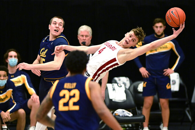 Washington State forward Aljaz Kunc (4) grabs a rebound away from California forward Grant Anticevich (15) during the first half of an NCAA college basketball game Thursday, Feb. 18, 2021, in Pullman, Wash. (AP Photo/Pete Caster)