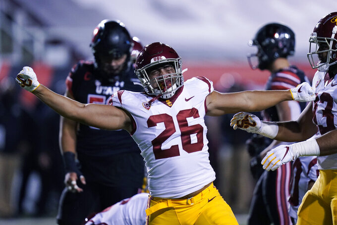Southern California linebacker Kana'i Mauga (26) reacts after making a tackle during the first half of the team's NCAA college football game against Utah on Saturday, Nov. 21, 2020, in Salt Lake City. (AP Photo/Rick Bowmer)