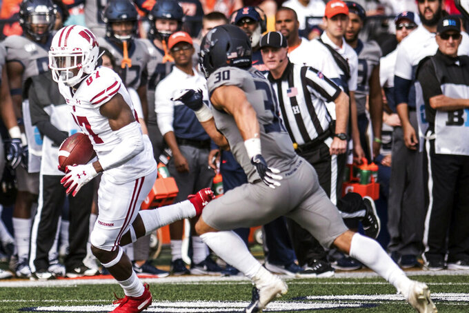 Wisconsin wide receiver Quintez Cephus (87) runs the ball after a reception as Illinois' Sydney Brown (30) defends in the first half of an NCAA college football game, Saturday, Oct.19, 2019, in Champaign, Ill. (AP Photo/Holly Hart)
