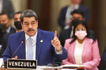In this handout photo provided by the Miraflores Press Office, Venezuela's President Nicolas Maduro speaks at theCommunity of Latin American and Caribbean States, or CELAC summit, in Mexico City, Saturday, Sept. 18, 2021. (Miraflores Press Office via AP)