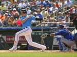 Miami Marlins' Brian Anderson (15) hits a single during the first inning  against the New York Mets during a spring training baseball game, Tuesday, March 12, 2019, in Jupiter, Fla. (David Santiago/Miami Herald via AP)