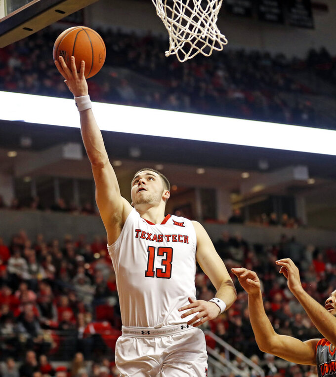 Texas Tech's Matt Mooney (13) lays up the ball during the first half of an NCAA college basketball game against Texas-Rio Grande Valley, Friday, Dec. 28, 2018, in Lubbock, Texas. (AP Photo/Brad Tollefson)