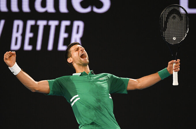 Serbia's Novak Djokovic celebrates after defeating United States' Talyor Fritz in their third round match at the Australian Open tennis championship in Melbourne, Australia, Saturday, Feb. 13, 2021.(AP Photo/Andy Brownbill)