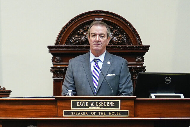 FILE - In this Wednesday, Feb. 19, 2020, file photo, Kentucky Republican Speaker of the House David Osborne stands at his desk on the floor of the House at the Capitol in Frankfort, Ky. A politically divisive proposal to revamp Kentucky's public assistance programs and tighten enforcement to prevent fraud won passage in the Republican-run state House on Friday.  The bill's lead sponsors are the House's top two Republican leaders, House Speaker David Osborne and House Speaker Pro Tem David Meade. (AP Photo/Bryan Woolston, File)