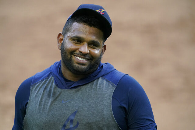 FILE - Atlanta Braves third baseman Pablo Sandoval smiles during batting practice before Game 5 of a baseball National League Championship Series against the Los Angeles Dodgers in Arlington, Texas, in this Friday, Oct. 16, 2020, file photo. The Braves have agreed to a minor league deal with veteran third baseman Pablo Sandoval. Sandoval would earn $1 million if he is added to the team's 40-man roster. (AP Photo/Tony Gutierrez, FIle)