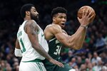 Milwaukee Bucks' Giannis Antetokounmpo (34) drives past Boston Celtics' Kyrie Irving (11) during the first half of Game 4 of a second-round NBA basketball playoff series in Boston, Monday, May 6, 2019. (AP Photo/Michael Dwyer)