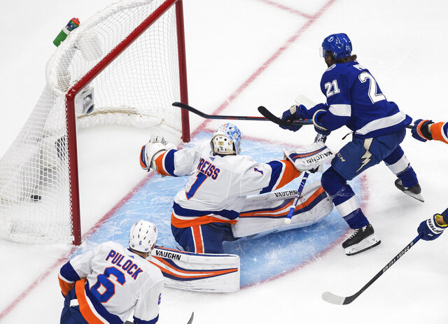 Tampa Bay Lightning's Brayden Point (21) scores on New York Islanders goalie Thomas Greiss (1) during the first period of an NHL Eastern Conference final playoff game, Monday, Sept. 7, 2020, in Edmonton, Alberta. (Jason Franson/The Canadian Press via AP)