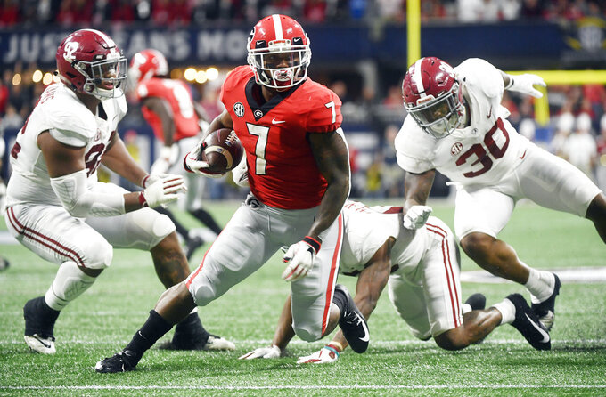 Georgia running back D'Andre Swift (7) runs against Alabama during the first half of the Southeastern Conference championship NCAA college football game, Saturday, Dec. 1, 2018, in Atlanta. (AP Photo/John Amis)