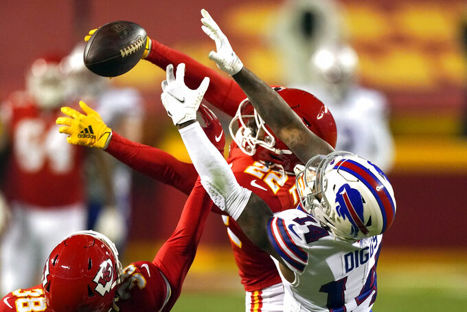 Kansas City Chiefs safety L'Jarius Sneed (38) and safety Juan Thornhill (22) break up a pass intended for Buffalo Bills wide receiver Stefon Diggs (14) during the second half of the AFC championship NFL football game, Sunday, Jan. 24, 2021, in Kansas City, Mo. (AP Photo/Charlie Riedel)