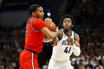 St. John's Julian Champagnie (2) and Villanova's Saddiq Bey (41) battle for the ball during the first half of an NCAA college basketball game, Wednesday, Feb. 26, 2020, in Villanova, Pa. (AP Photo/Matt Slocum)