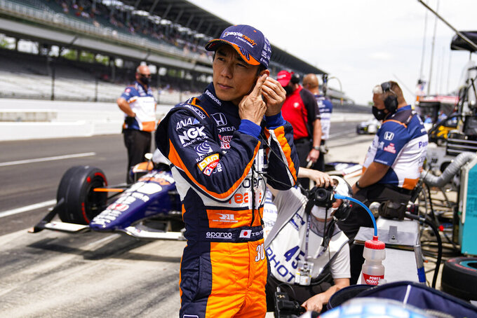 Takuma Sato, of Japan, prepares to drive during practice for the Indianapolis 500 auto race at Indianapolis Motor Speedway in Indianapolis, Friday, May 21, 2021. (AP Photo/Michael Conroy)