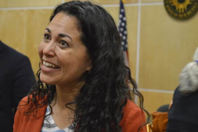 In this Feb. 18, 2020, photo, U.S. Rep. Xochitl Torres Small, D-Las Cruces, speaks to voters during a town hall meeting in Belen, N.M. Torres Small announced Thursday, March 19, 2020, she will go into self-quarantine after coming in contact with someone who tested positive for the coronavirus. (AP Photo/Russell Contreras)