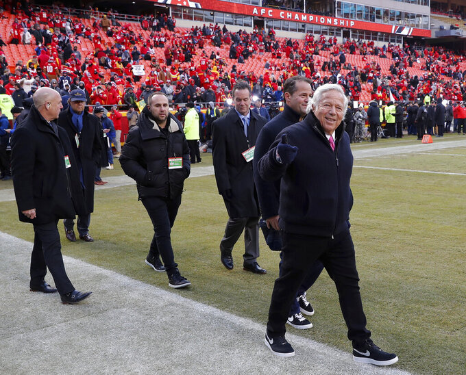 New England Patriots owner Robert Kraft, right, arrives on the field before the AFC Championship NFL football game between the Kansas City Chiefs and the New England Patriots, Sunday, Jan. 20, 2019, in Kansas City, Mo. (AP Photo/Charlie Neibergall)