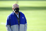 New York Giants owner John Mara wears a face mask to protect against COVID-19 prior to an NFL football game against the Baltimore Ravens, Sunday, Dec. 27, 2020, in Baltimore. While sick of the losing seasons, co-owner John Mara felt the New York Giants established a foundation and culture under rookie coach Joe Judge, giving him optimism the playoffs may not be far away. Mara also disclosed Wednesday, Jan. 6, 2021, 69-year-old Dave Gettleman would be back for a fourth season. (AP Photo/Gail Burton)