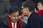 FILE - In this Jan. 25, 2012, file photo, Liverpool owners John Henry, right, and Tom Werner speak before their side's English League Cup semifinal second leg soccer match against Manchester City at Anfield Stadium in Liverpool, England.  Liverpool won its first league title since 1990, clinching Thursday, June, 25, 2020. Because of the pandemic, Henry and Werner, who headed the group that bought the team in 2010, watched on television from the U.S. (AP Photo/Tim Hales, File)