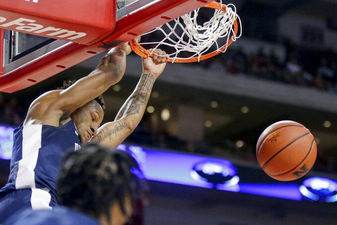 Penn State's Lamar Stevens (11) dunks during the second half of an NCAA college basketball game against Nebraska in Lincoln, Neb., Saturday, Feb. 1, 2020. (AP Photo/Nati Harnik)