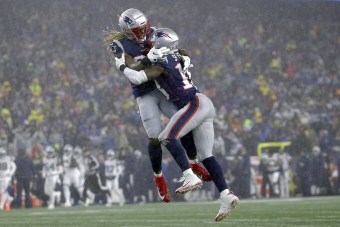 New England Patriots running back Brandon Bolden, left, celebrates a blocked punt by Matthew Slater, right, in the first half of an NFL football game against the Dallas Cowboys, Sunday, Nov. 24, 2019, in Foxborough, Mass. (AP Photo/Elise Amendola)
