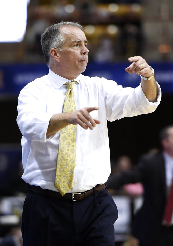 Wofford Terriers head coach Mike Young directs his team against VMI in the second half of an NCAA college basketball game for the Southern Conference basketball tournament championship, Saturday, March 9, 2018, in Asheville, N.C. Wofford won 99-72. (AP Photo/Kathy Kmonicek)