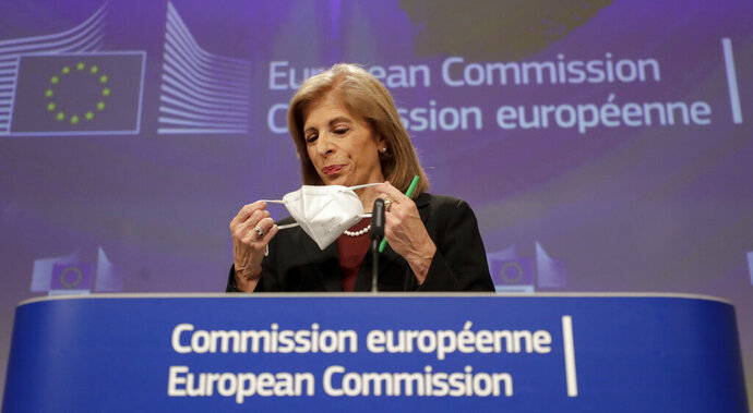 European Commissioner in charge of Health Stella Kyriakides removes her face mask during an online press conference on AstraZeneca at European Commission headquarters in Brussels, Wednesday, Jan. 27, 2021. (Olivier Hoslet/Pool Photo via AP)