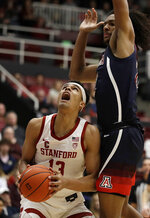Arizona's Zeke Nnaji, right, defends against Stanford's Oscar da Silva (13) during the first half of an NCAA college basketball game Saturday, Feb. 15, 2020, in Stanford, Calif. (AP Photo/Ben Margot)