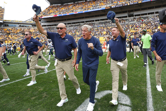 Seattle Seahawks head coach Pete Carroll, center,  celebrates with other coaches as they take the field after defeating the Pittsburgh Steelers 28-26 in an NFL football game, Sunday, Sept. 15, 2019, in Pittsburgh. (AP Photo/Don Wright)