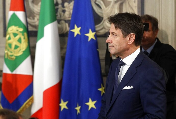 Italian Premier Giuseppe Conte arrives at Rome's Quirinale Presidential Palace, Wednesday, Sept. 4, 2019. The Italian presidential palace says Premier Giuseppe Conte has formed a new government, a coalition of the populist 5-Star Movement and left-leaning Democrats that shuts out of power right-wing leader Matteo Salvini. (AP Photo/Gregorio Borgia)