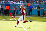 FILE - In this Oct. 13, 2019, file photo, Washington Redskins' Tress Way (5) punts during the first half at an NFL football game against the Miami Dolphins, in Miami Gardens, Fla. A popular Redskins podcast is trying to send Washington punter Tress Way to the Pro Bowl. Way leads all NFC punters in net yards and has pinned opponents inside the 20-yard line 24 times this season. (AP Photo/Wilfredo Lee, File)