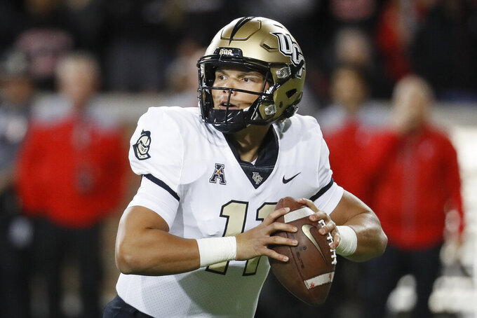 UCF quarterback Dillon Gabriel looks to pass during the first half of the team's NCAA college football game against Cincinnati, Friday, Oct. 4, 2019, in Cincinnati. (AP Photo/John Minchillo)
