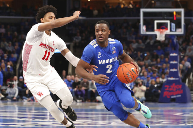 Memphis guard Alex Lomax (2) heads to the basket as Houston guard Nate Hinton defends in the second half of an NCAA college basketball game Saturday, Feb. 22, 2020, in Memphis, Tenn. (AP Photo/Karen Pulfer Focht)