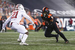 Oregon State wide receiver Kolby Taylor (5) squares off with Stanford strong safety Kendall Williamson (21) during the second half of an NCAA college football game in Corvallis, Ore., Saturday, Dec. 12, 2020. Stanford won 27-24. (AP Photo/Amanda Loman)