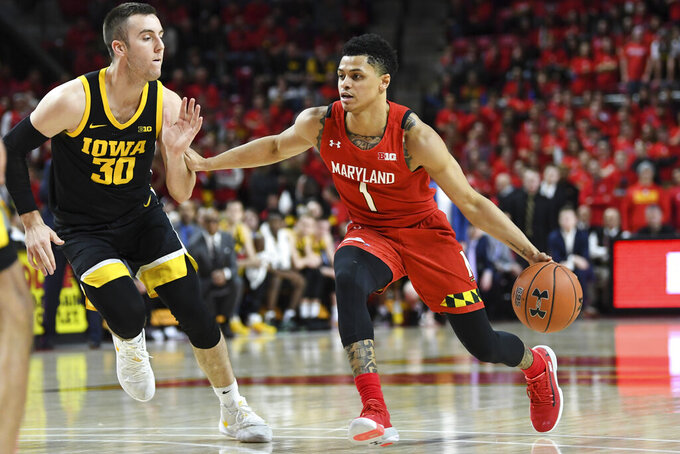 Maryland guard Anthony Cowan Jr. (1) drives to the basket against Iowa guard Connor McCaffery (30) during the second half of an NCAA college basketball game Thursday, Jan. 30, 2020, in College Park, Md. (AP Photo/Terrance Williams)