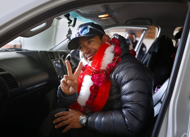 Nepalese climber Nirmal Purja, who along with his team recently made history by scaling the K2 summit in the winter season, flashes a victory sign on his arrival to the airport in Islamabad, Pakistan, Thursday, Jan. 21, 2021. Winter winds on K2 can blow at more than 200 km per hour (125 miles per hour) and temperatures can drop to minus 60 C (minus 76 F), an official of Pakistan's Alpine Club, Karrar Haideri said. (AP Photo/Anjum Naveed)