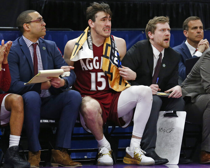 New Mexico State forward Ivan Aurrecoechea (15) looks on as he sits on the bench in the second half of a first round men's college basketball game against Auburn in the NCAA Tournament, Thursday, March 21, 2019, in Salt Lake City. (AP Photo/Rick Bowmer)
