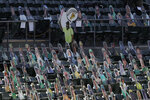 Cardboard cutouts of a vendor, fans and former Oakland Athletics players are placed in seats at Oakland Coliseum before a baseball game between the Athletics and the Los Angeles Angels in Oakland, Calif., Friday, July 24, 2020. (AP Photo/Jeff Chiu)
