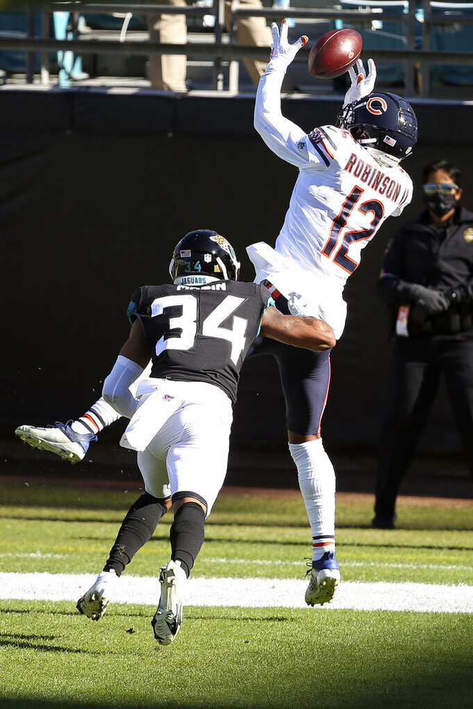 Jacksonville Jaguars cornerback Greg Mabin (34) breaks up a pass intended for Chicago Bears wide receiver Allen Robinson II (12) during the first half of an NFL football game, Sunday, Dec. 27, 2020, in Jacksonville, Fla. (AP Photo/Stephen B. Morton)