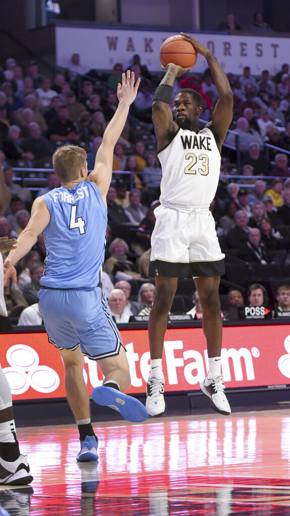 Wake Forest's Chaundee Brown prepares to sink a basket under pressure from Columbia's Jack Forrest in the first half of an NCAA college basketball game, Sunday, Nov. 10, 2019, in Winston-Salem, N.C. (Walt Unks/Winston-Salem Journal via AP)