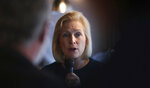 """FILE - In this May 10, 2019, file photo, Democratic presidential candidate Sen. Kirsten Gillibrand, D-N.Y., talks with guests during a campaign stop at a coffee shop in Derry, N.H. Gillibrand has released a """"Family Bill of Rights"""" that she vows to institute during her first 100 days in the White House, if elected(AP Photo/Charles Krupa, File)"""