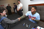 Minnesota Twins' Jose Berrios, right, shakes the hand of 7-year-old Lukas Winkels after giving an autograph during the baseball team's TwinsFest, Friday, Jan. 24, 2020, in Minneapolis. (AP Photo/Stacy Bengs)