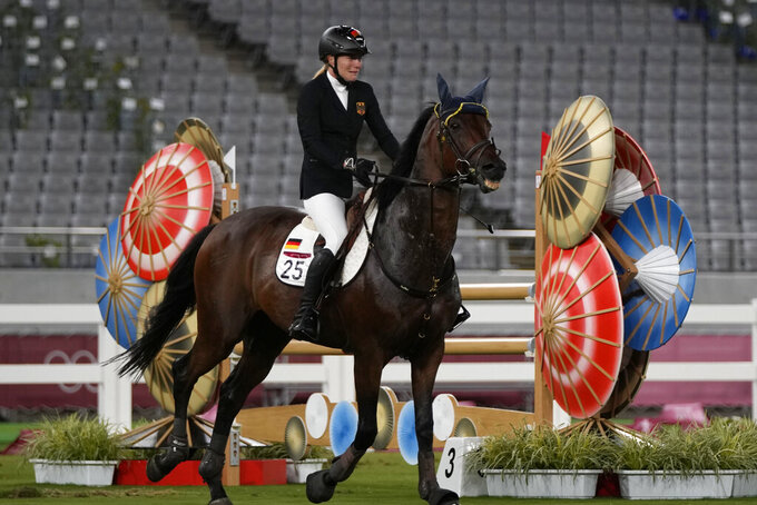 German coach suspended for striking horse at Olympics