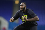 FILE - In this Feb. 28, 2020, file photo, Georgia offensive lineman Andrew Thomas runs a drill at the NFL football scouting combine in Indianapolis. With the No. 11 overall pick in the NFL draft, the Jets will have the opportunity to add an impact player early.  Jets GM Joe Douglas' goal entering the offseason was to improve the offensive line and add playmakers. (AP Photo/Michael Conroy, File)