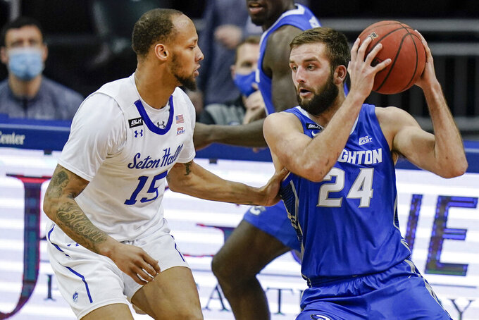 Creighton's Mitch Ballock (24) protects the ball from Seton Hall's Takal Molson (15) during the second half of an NCAA college basketball game Wednesday, Jan. 27, 2021, in Newark, N.J. Creighton won 85-81. (AP Photo/Frank Franklin II)