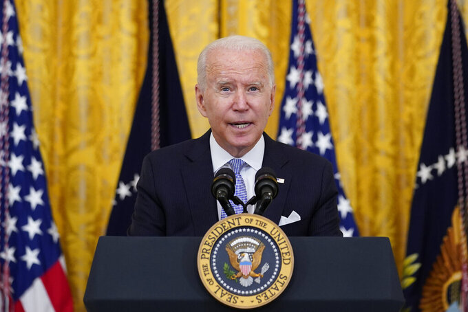FILE - President Joe Biden speaks from the East Room of the White House in Washington, Thursday, July 29, 2021.  An array of progressive and pro-White House groups plans to spend nearly $100 million to promote Biden's agenda over the next month to pressure Congress while lawmakers are on their August recess. The push being announced Monday, Aug. 2 coupled with a wave of travel by the president's top surrogates, is meant to promote and secure passage of Biden's two-track infrastructure plan. (AP Photo/Susan Walsh, File)